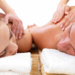 One 60-Minute Couples Massage with Glass of Wine and Essential Oils